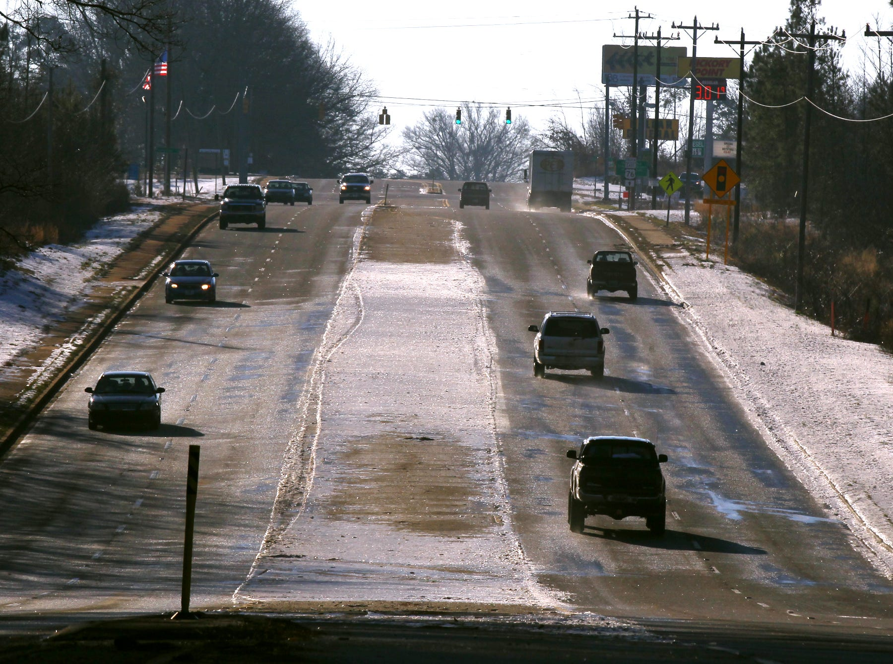 Cars drive over black ice and melted snow on the Belton Highway outside of the Anderson city limits in 2014.