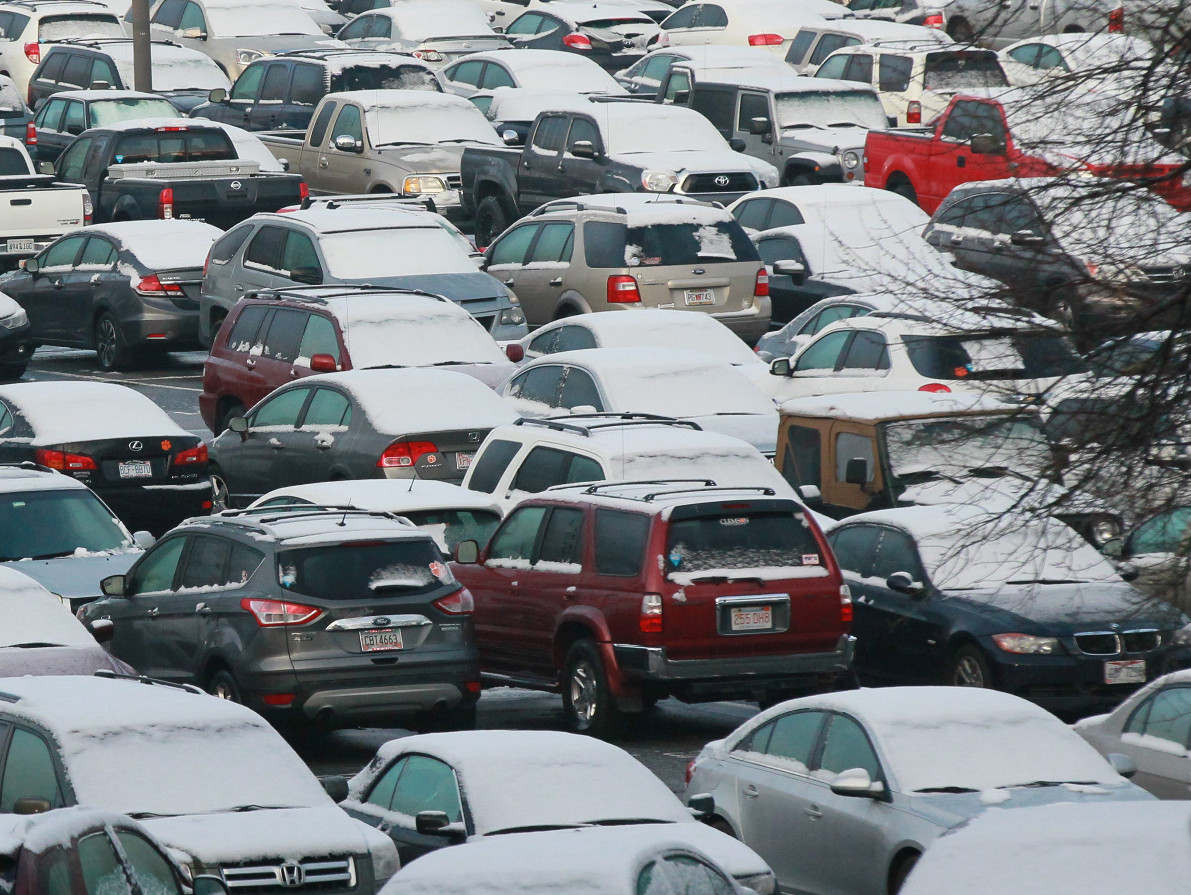 Snow covers student vehicles parked near Memorial Stadium at Clemson University in 2015.