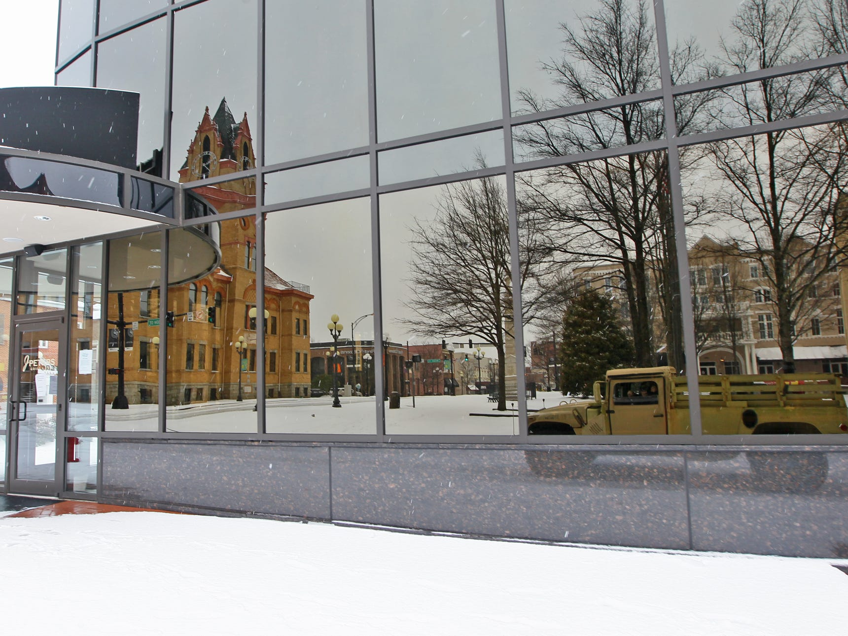 A reflection of the Historic County Courthouse, seen in the windows of J. Peters restaurant in downtown Anderson during the first snow of 2014.