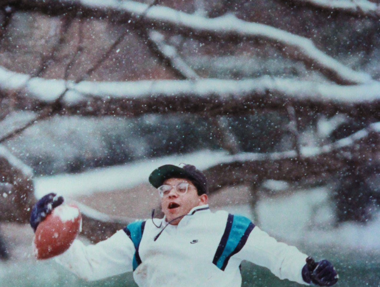 Pinakin Desai, a sophomore at Clemson University, catches a football thrown by one of his classmates Feburary 23, 1993. The snow was a break from his engineering classes.