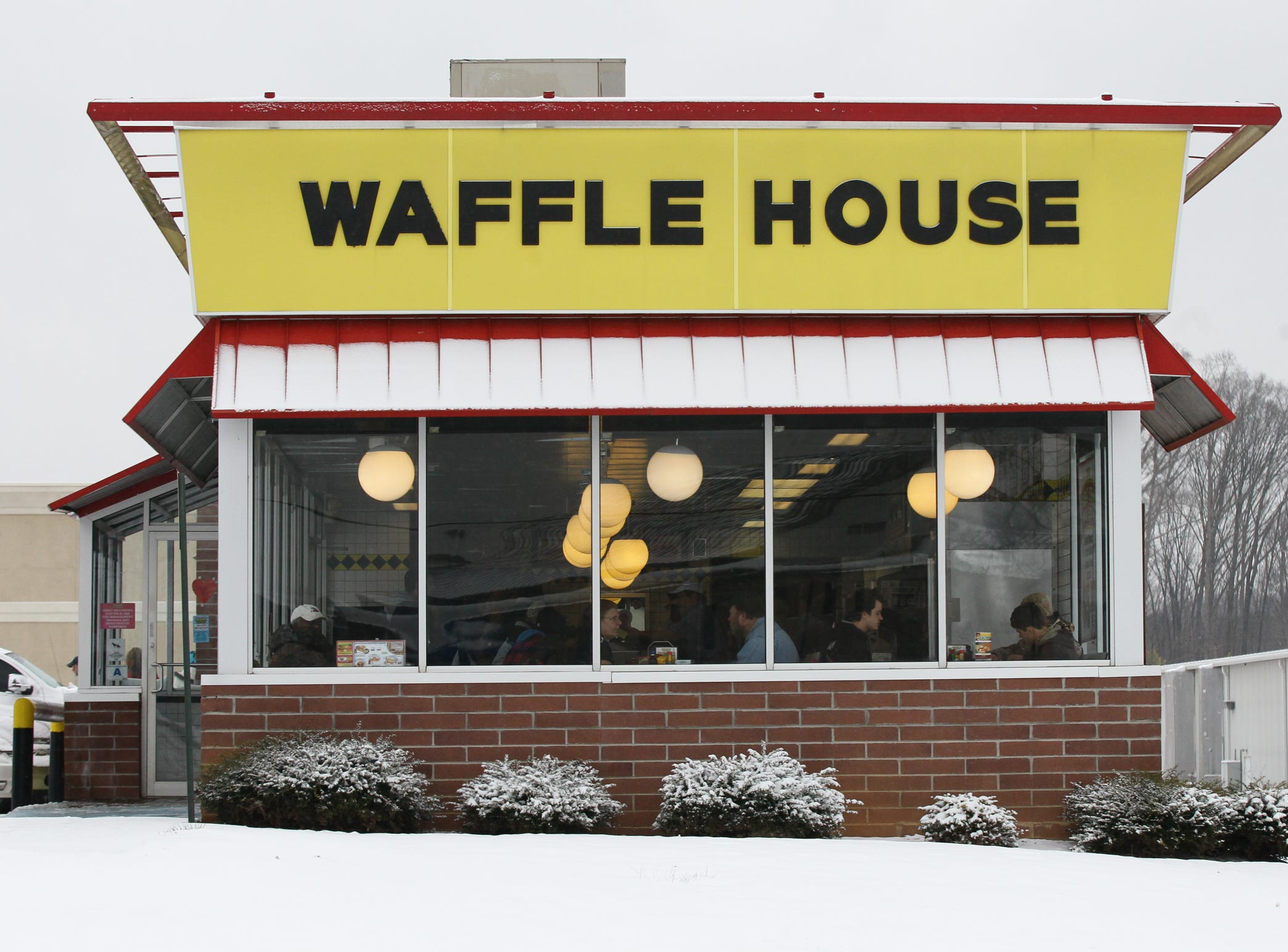 People dine in the Waffle House restaurant on Liberty Highway in Anderson during the first snow of 2014.