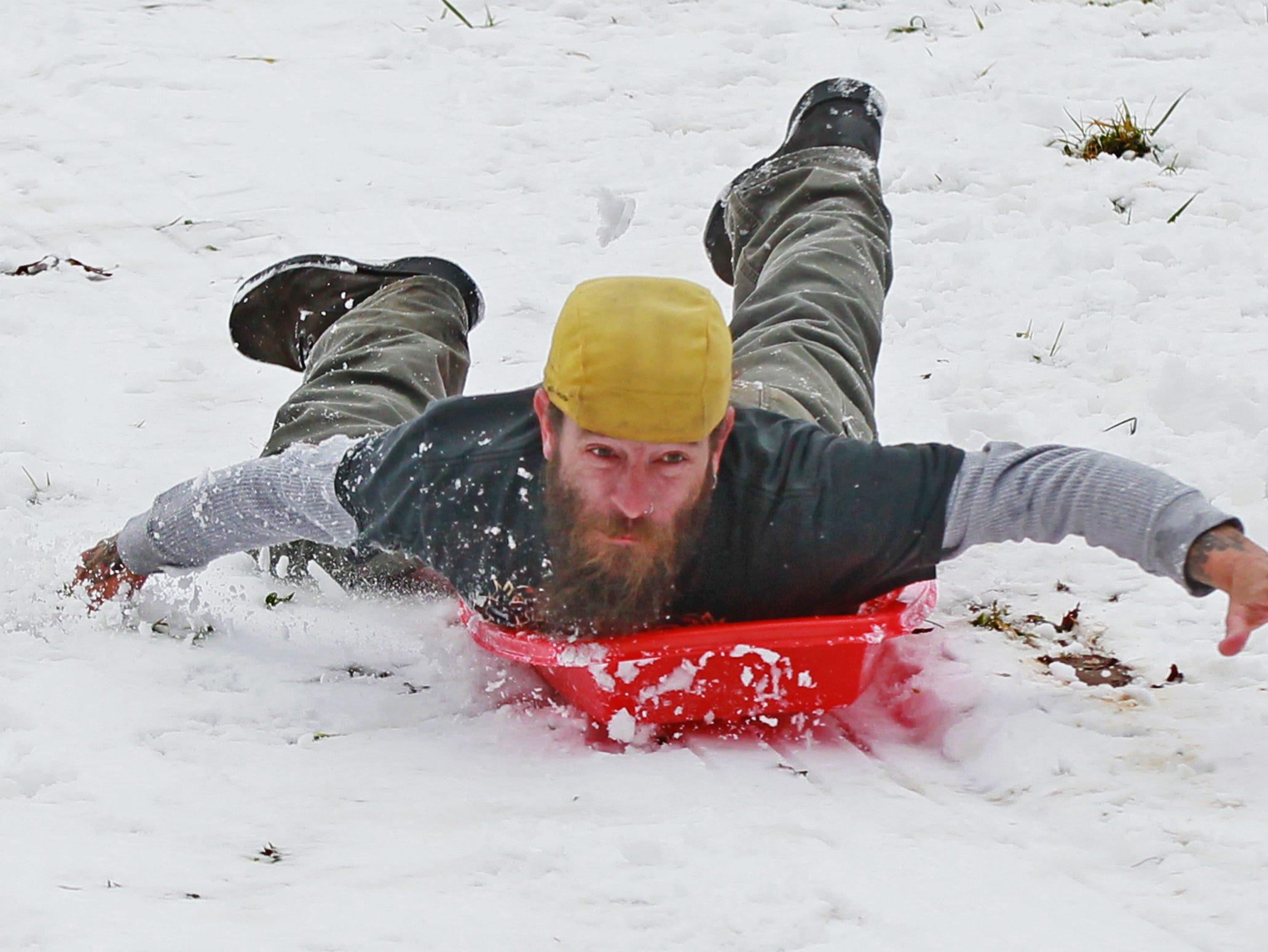Michael Tucker of Walhalla slides head-first down a snowy hill at Depot Park in Walhalla in 2015.