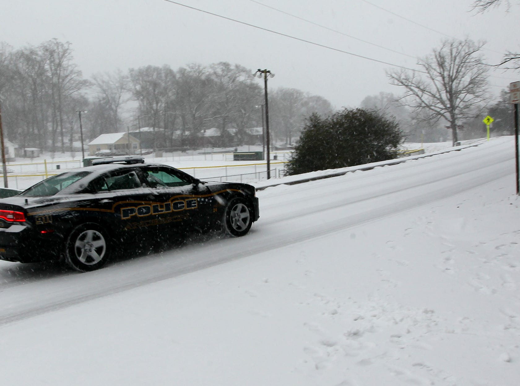 An Anderson police car drives by Linley Park in Anderson in 2014.