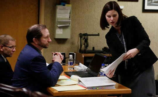 Winnebago County Assistant District Attorney Amanda Folger shows defense attorney Brandt Swardenski evidence during the trial of Fox Crossing Municipal Judge Len Kachinsky Thursday. Kachinsky was standing trial on a stalking charge related to his treatment of his court clerk, Mandy Bartelt.