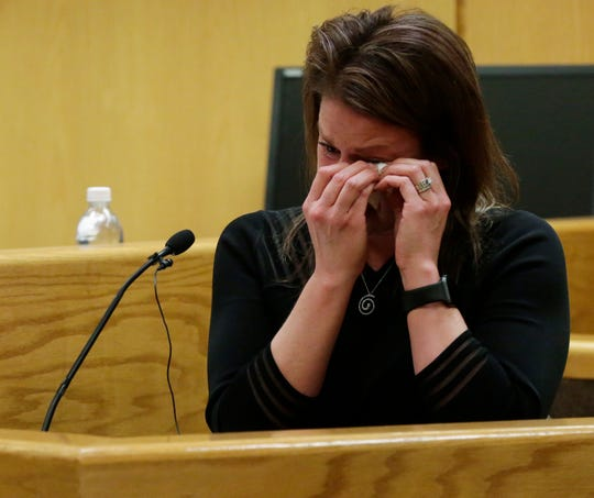 Fox Crossing Municipal Court clerk Mandy Bartelt cries as she testifies during the trial of Fox Crossing Municipal Judge Len Kachinsky Thursday. Kachinsky is facing a stalking charge related to his treatment of her.