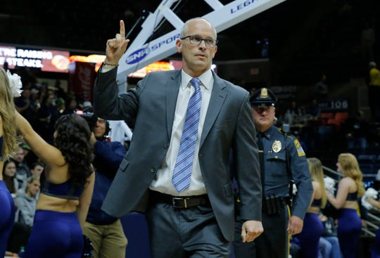 Connecticut Huskies head coach Dan Hurley makes his way onto the court before the start of the game against the UMKC Kangaroos at Gampel Pavilion.