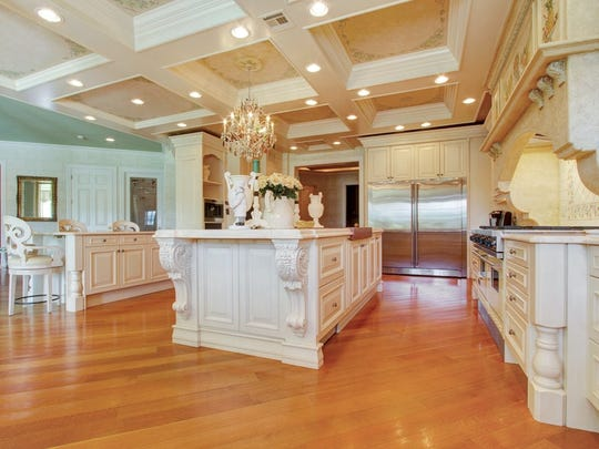 The Kitchen has a coffered ceiling with hand-painted detail.