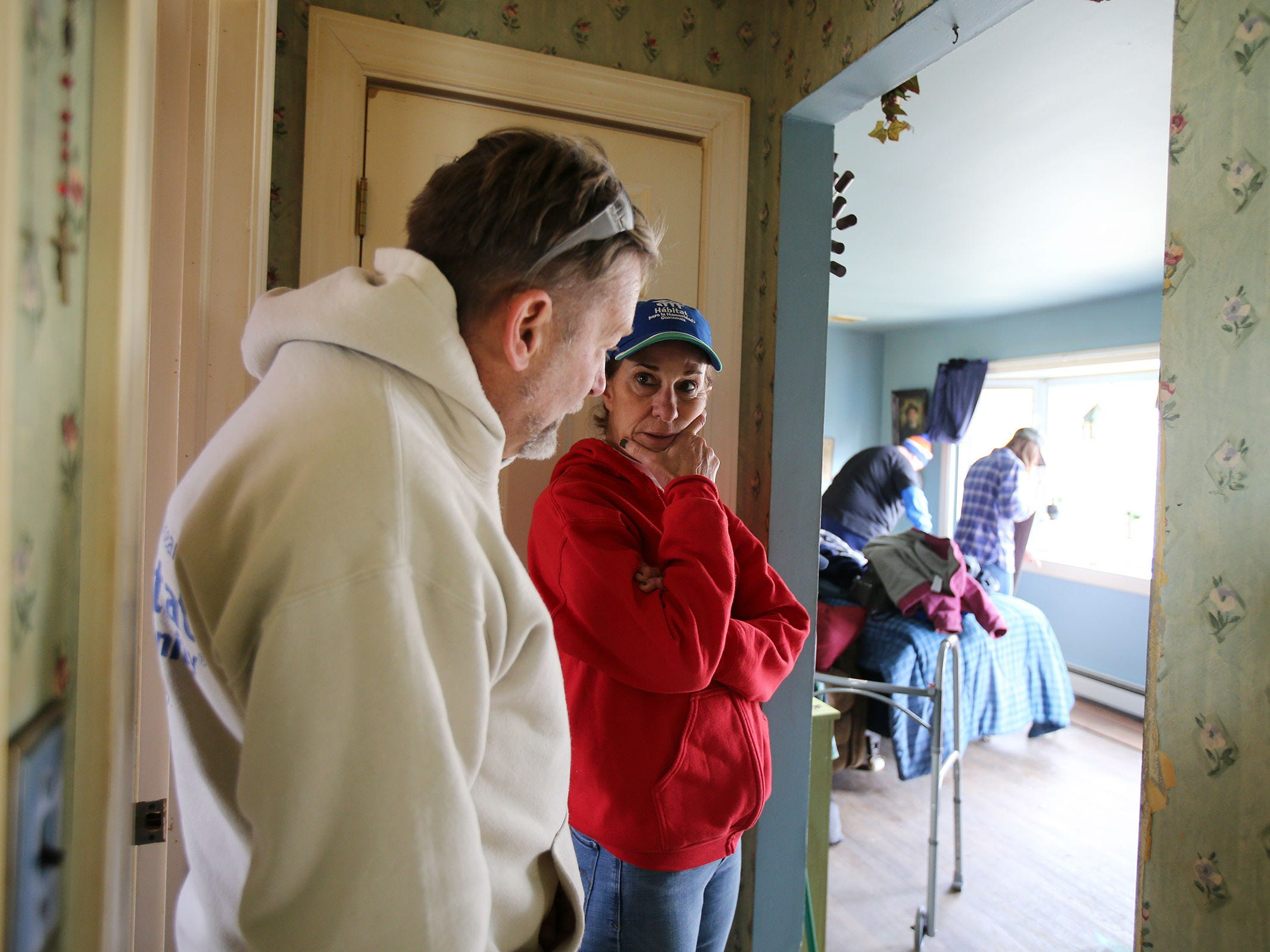 Bob Conway of Whiting, construction supervisor, and Suzan Fichtner, executive director, discuss the progress as volunteers from Northern Ocean Habitat for Humanity work on the home of Korean War veteran Walter Brandon, 85, and wife Patricia in Brick, NJ Thursday, December 6, 2018.  This is Northern Ocean Habitat for Humanity's 200th home repair.