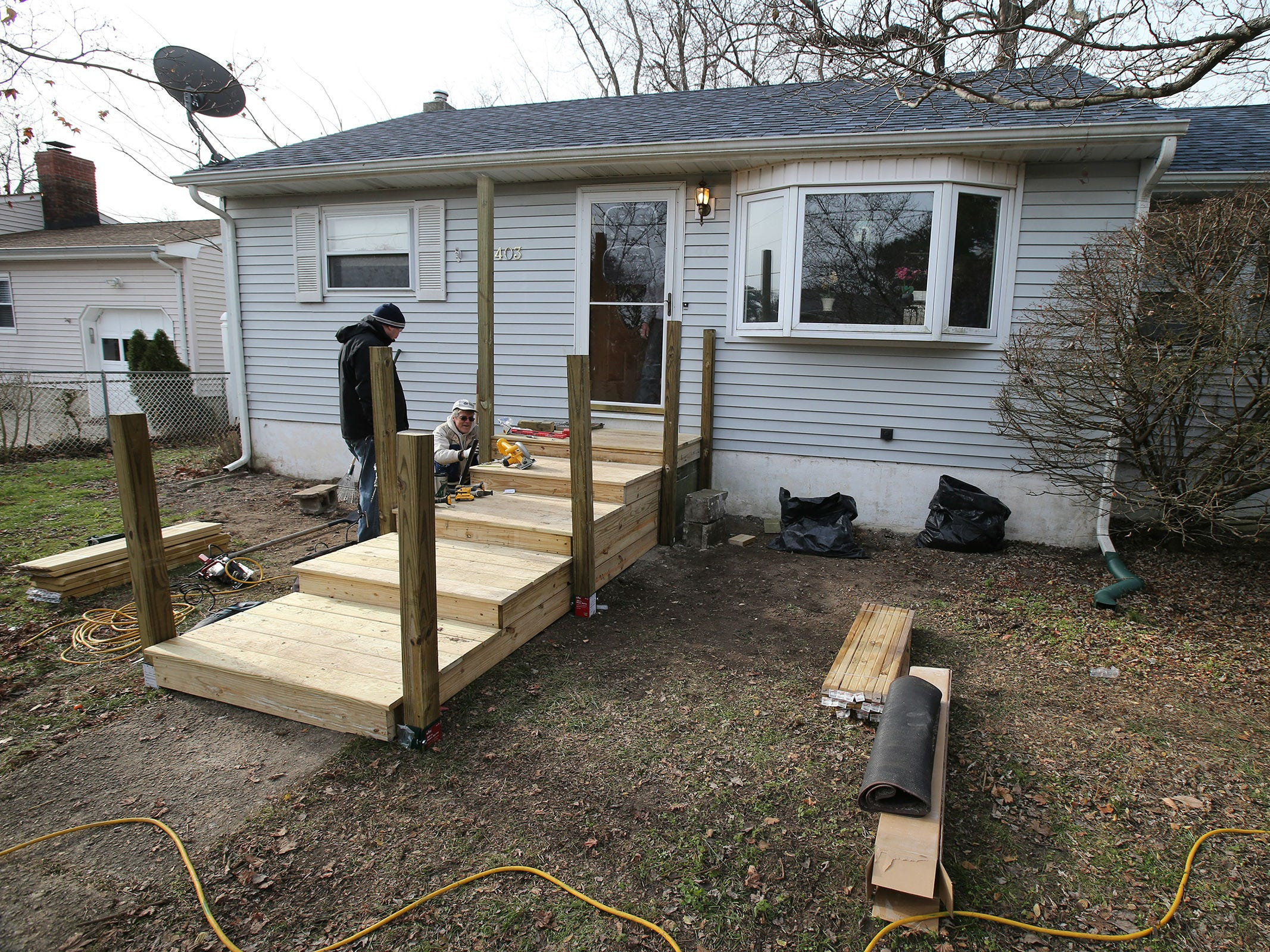 Northern Ocean Habitat for Humanity works on the home of Korean War veteran Walter Brandon, 85, and wife Patricia, which is their 200th home repair, in Brick, NJ Thursday, December 6, 2018.