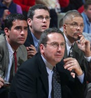 Rutgers basketball coaches Geoff Billet (far left), Dan Hurley (top center) and Associate Head Coach Rod Baker (right) join Head Coach Kevin Bannon (lower center) watch as Rutgers take the win over Fairleigh Dickinson in an undated photo.