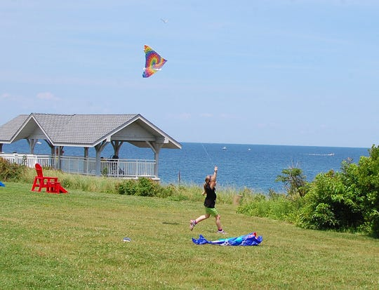 Jessica Curia flies her kite on the bluff of the Stella Maris Retreat Center at the annual Summer Solstice Celebration in 2012 in the Elberon section of Long Branch. The grounds overlook the Atlantic Ocean.