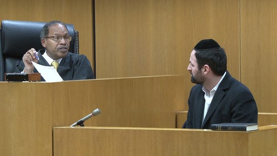 Ocean County Superior Court Judge Wendel Daniels questions Moshe Hirschmann on Thursday during a 11-minute hearing in which Hirshmann pleaded guilty to theft of Medicaid and food stamp benefits.