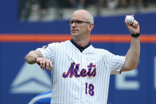 UConn basketball coach Dan Hurley throws a pitch before the game between the New York Mets and the Chicago Cubs at Citi Field.
