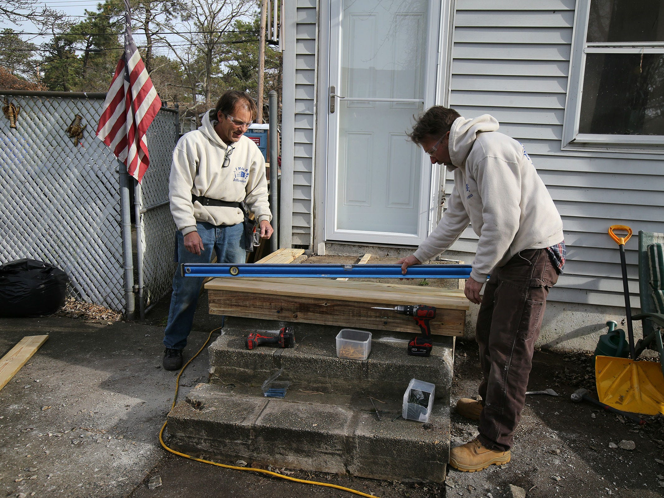 Todd Reinhardt of Seaside Park, construction foreman for Northern Ocean Habitat for Humanity, and Bob Conway of Whiting, construction supervisor for Northern Ocean Habitat for Humanity, work on the home of Korean War veteran Walter Brandon, 85, and wife Patricia, which is Northern Ocean Habitat for Humanity's 200th home repair, in Brick, NJ Thursday, December 6, 2018.
