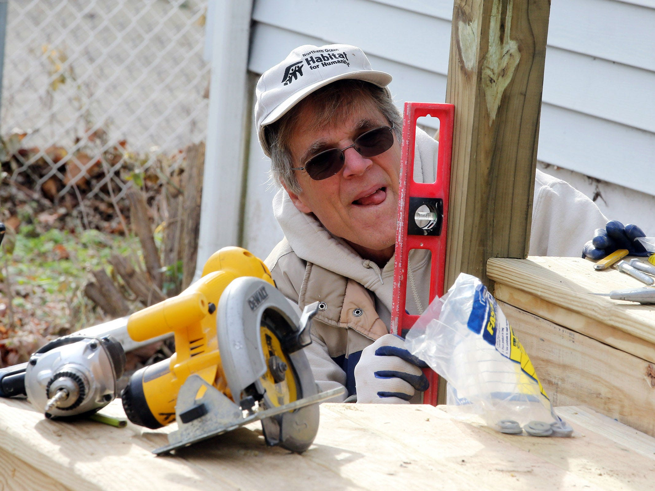Jeff Dickert of New Egypt volunteers with Northern Ocean Habitat for Humanity as they work on the home of Korean War veteran Walter Brandon, 85, and wife Patricia, which is Northern Ocean Habitat for Humanity's 200th home repair, in Brick, NJ Thursday, December 6, 2018.