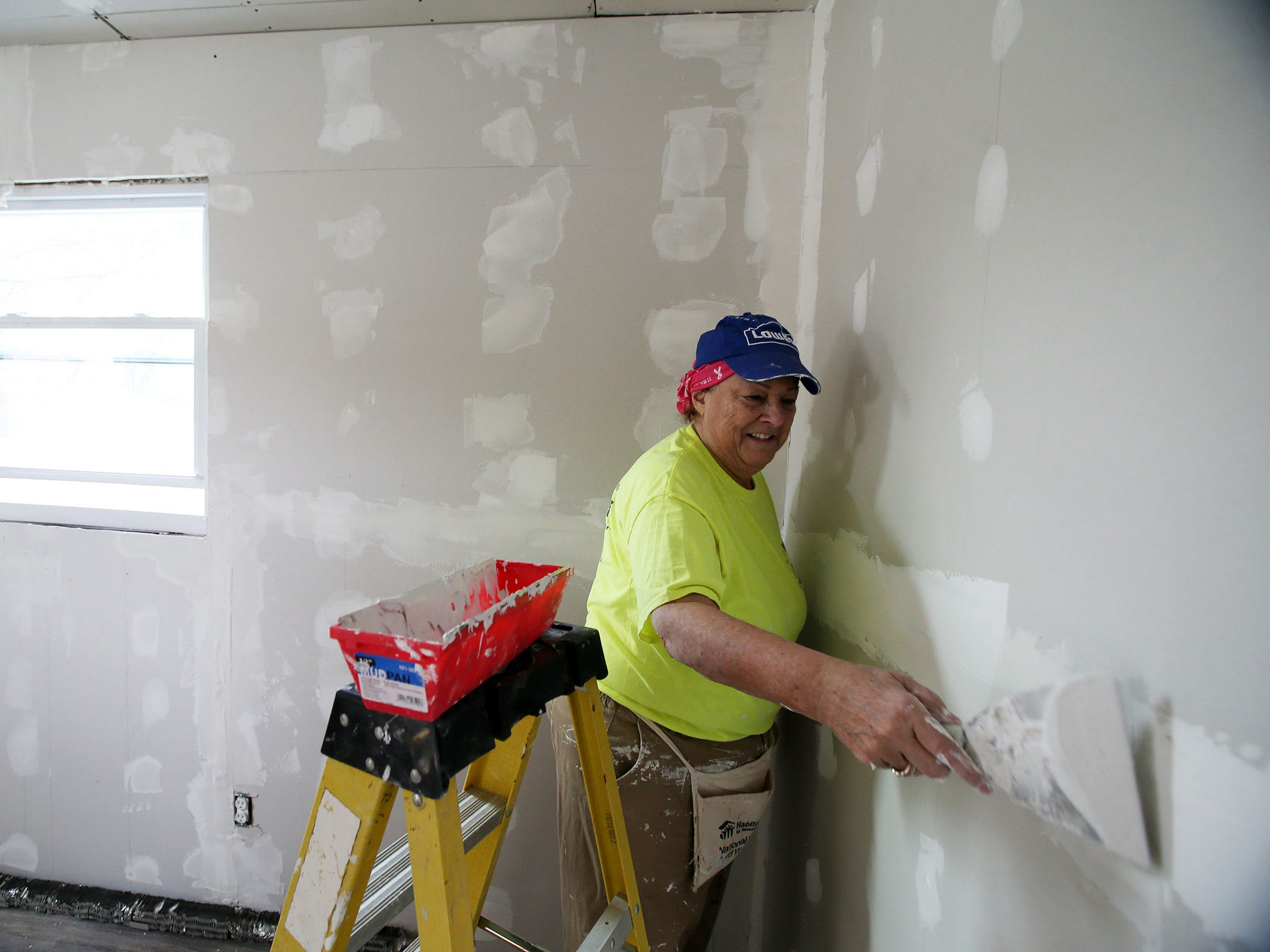 Gerry Pizzi of Toms River, a volunteer for Northern Ocean Habitat for Humanity, works on the home of Korean War veteran Walter Brandon, 85, and wife Patricia in Brick, NJ Thursday, December 6, 2018.  This is Northern Ocean Habitat for Humanity's 200th home repair.