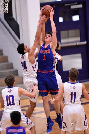 Cooper's Deven Bailey (1) pulls down a rebound surrounded by Midland Christian players at the Catclaw Classic hosted by Wylie on Thursday, Dec. 6, 2018.