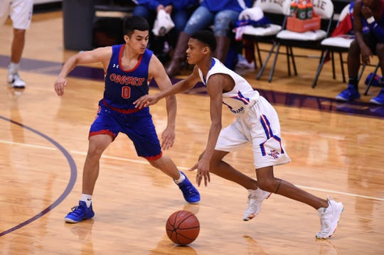 Cooper's Josh Henry (0) defends against Midland Christian at the Catclaw Classic.