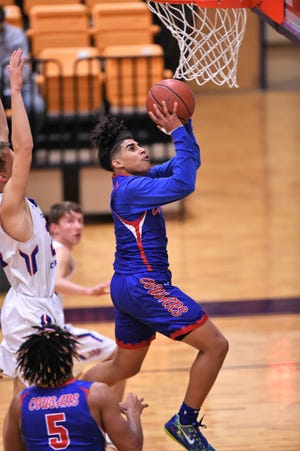Cooper's Noah Garcia (3) goes up and lays it in against Midland Christian at the Catclaw Classic hosted by Wylie on Thursday. The Cougars will face Abilene High and Fort Worth Chisholm Trail on Friday.