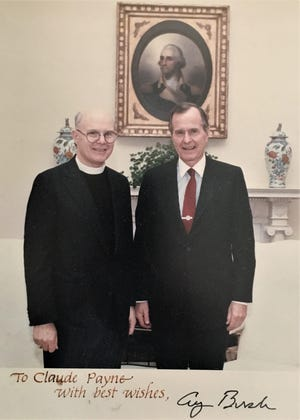 The Rev. Claude Payne and President George H.W. Bush posed for a picture in the White House in 1989.