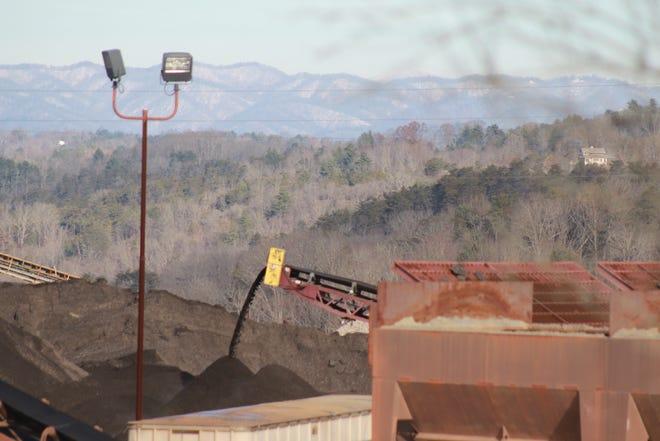 A conveyor belts runs inside the Weaverville asphalt plant.