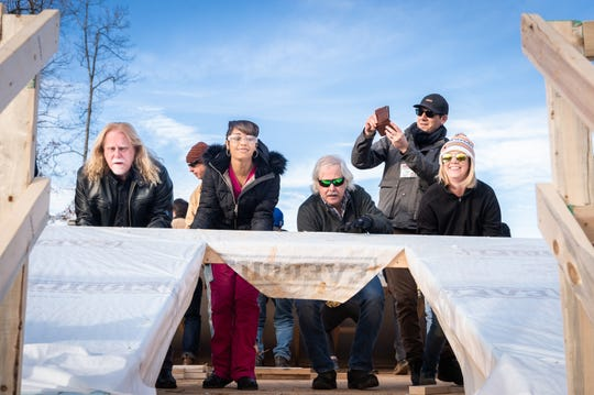 Musician Warren Haynes, on left, helps with raising a wall with Marquita Scott, beside him, currently residing in East Asheville, at the site of her future Habitat for Humanity home in Candler, Dec. 6, 2018.