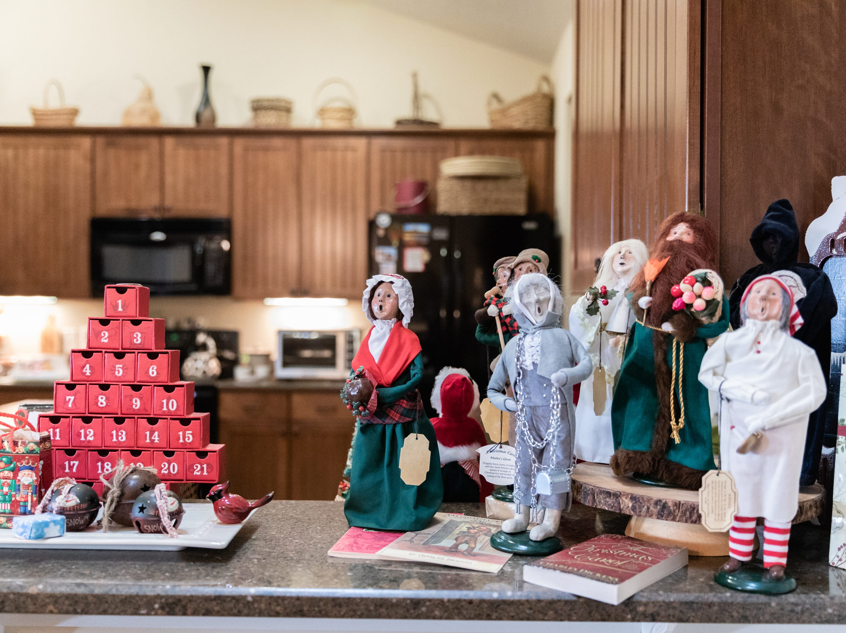 Nancy Snavely and Ken Snavely, of Candler, have been collecting Byer's Choice Carolers figurines for over 40 years. They have over 225 displayed in their home for the holidays.