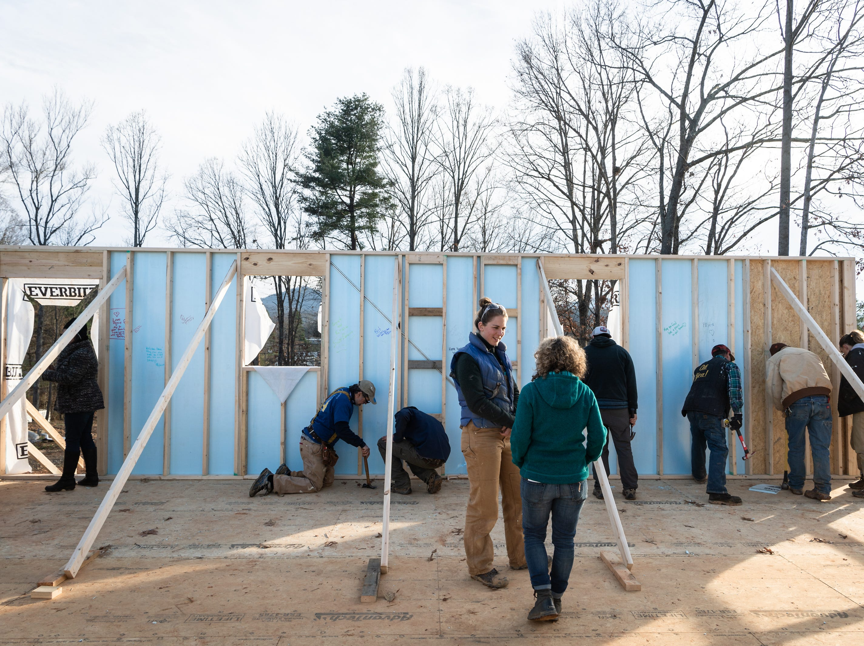 Members of the community, as well as musician Warren Haynes were in attendance in Candler to contribute to the wall raising at the site of Marquita Scott's new Habitat for Humanity home, Dec 6, 2018.