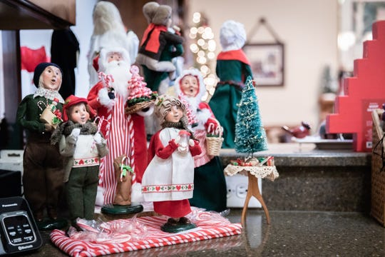 The Snavelys have very few Santas in their collection of Christmas figurines from Byers' Choice.