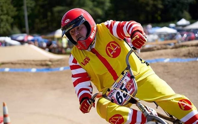 "Ron McDonald of Battle Creek competes in a BMX race while wearing his specialty-designed ""Big Mac"" uniform."