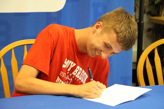 Noah Farrelly signed a National Letter of Intent to run for Stony Brook University May 29, 2018.