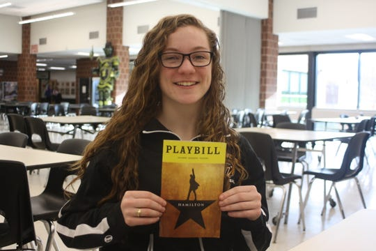 "Windsor Central High School junior Samantha Sova holds a ""Hamilton"" playbill in Windsor High School's cafeteria."