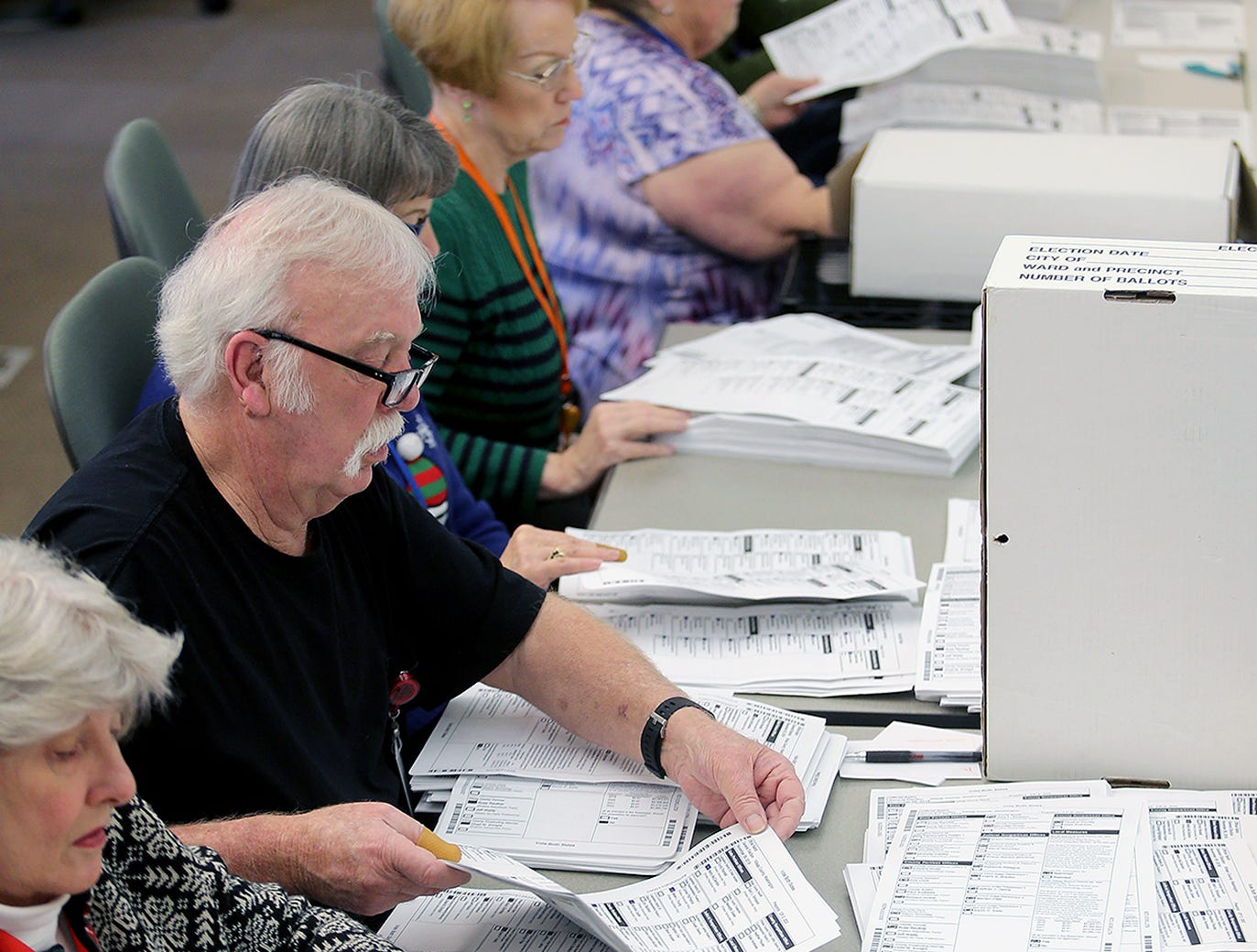 A recount for the 26th LD Senate race is in progress Thursday, December, 6, 2018 at the Kitsap County Elections Department in Port Orchard. Results will be certified on Friday.