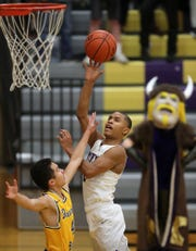 Kobe McMillan of North Kitsap is one of the best shooters in the Olympic League, his coach says.