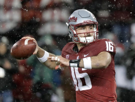 In this Nov. 23, 2018, file photo, Washington State quarterback Gardner Minshew passes against Washington during the first half of an NCAA college football game in Pullman, Wash. Minshew was named the Pac-12 offensive player of the year and the newcomer of the year Thursday, Dec. 6, 2018.