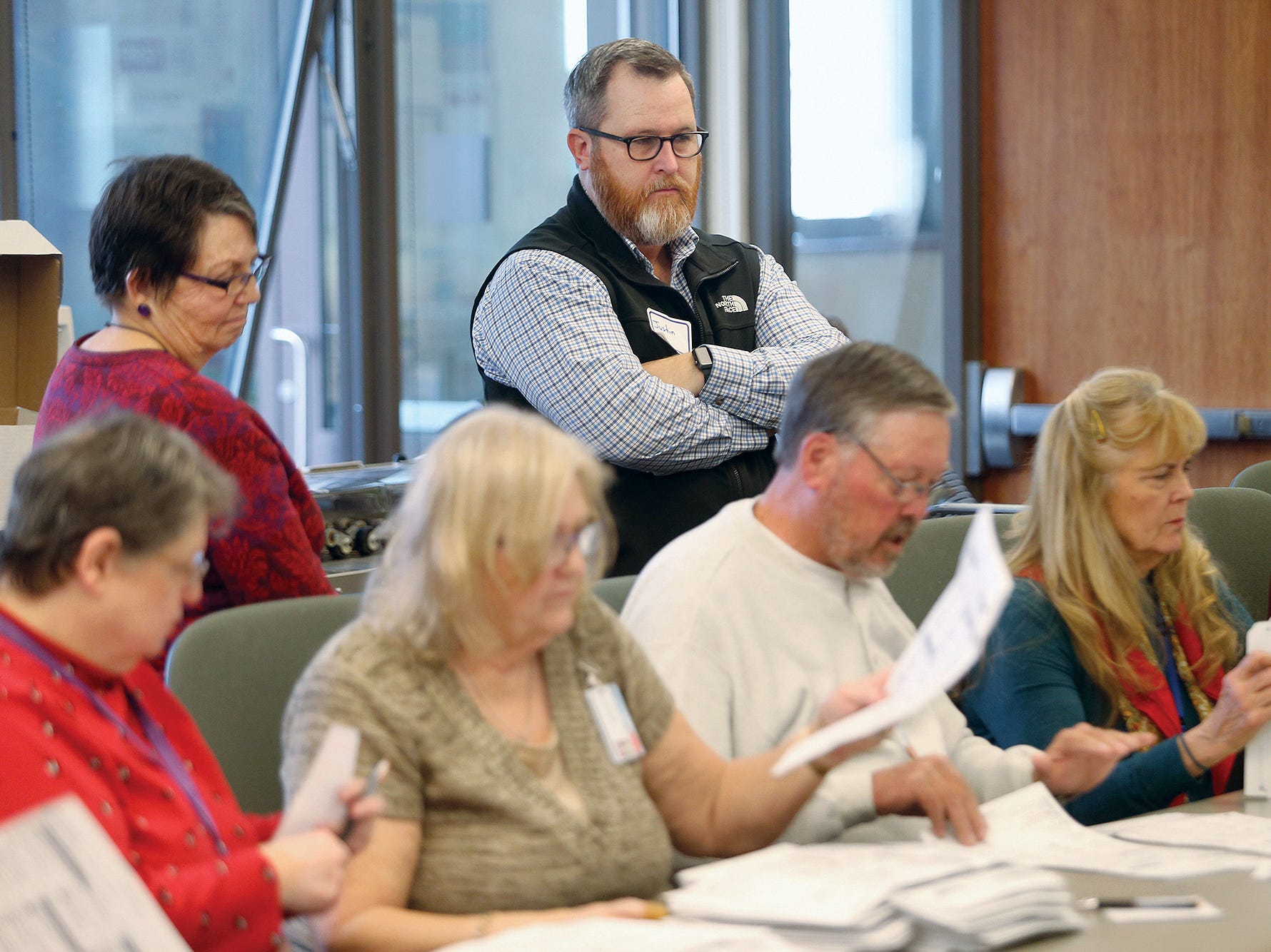 Election observers watch the recount for the 26th LD Senate race  in progress Thursday, December, 6, 2018 at the Kitsap County Elections Department in Port Orchard. Results will be certified on Friday.