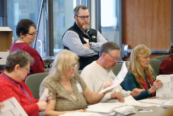 Elections officials in Kitsap and Pierce counties on Dec. 6, 2018, conducted a manual recount of more than 70,000 ballots cast in the 26th Legislative District Senate race. Democrat Emily Randall beat Republican Marty McClendon by 102 votes, the recount showed.