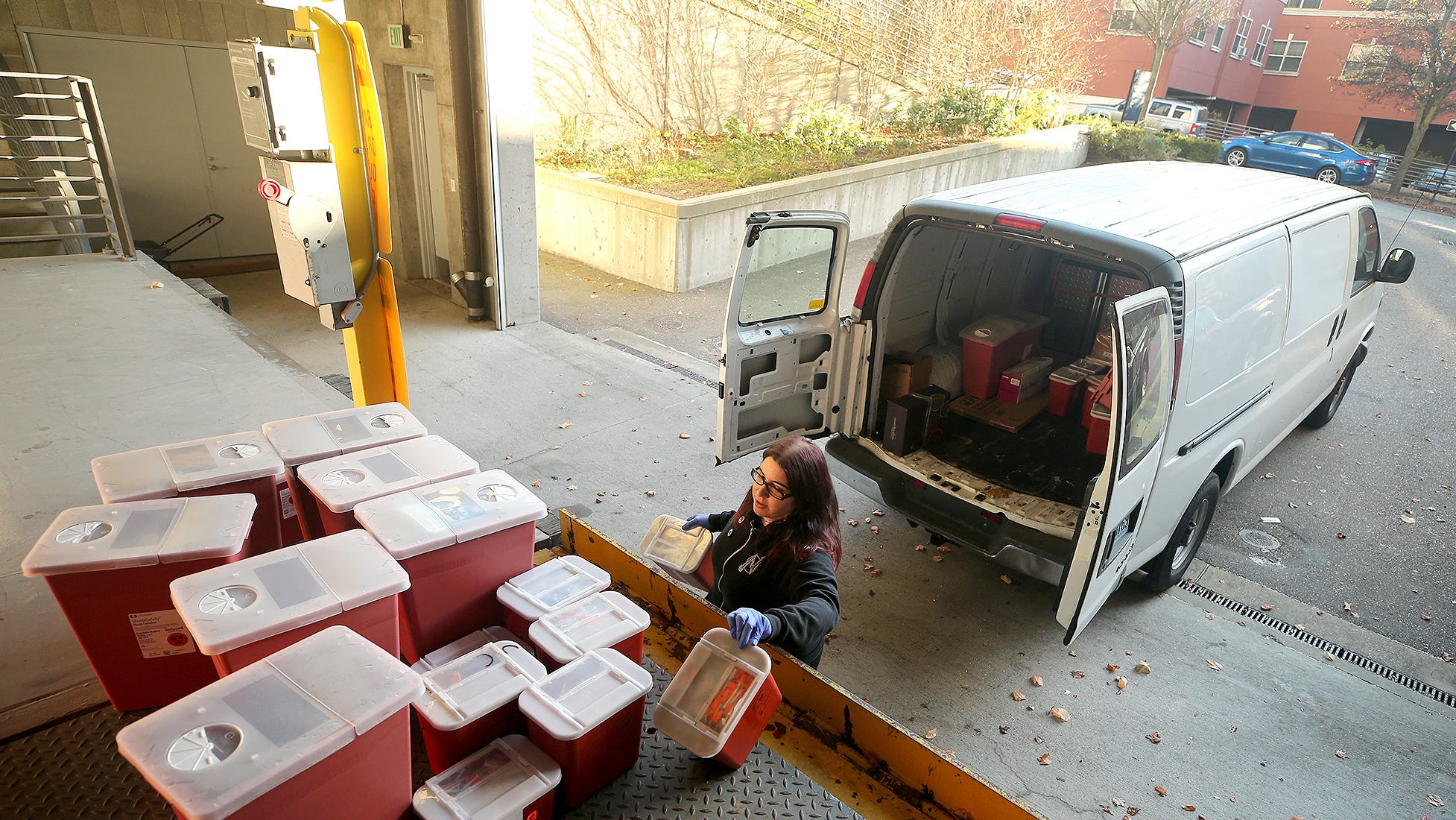 Lisa Al-Hakim, director of operations of the People's Harm Reduction Alliance, unloads used syringes at the Norm Dicks Government Center on Thursday, December, 6, 2018.