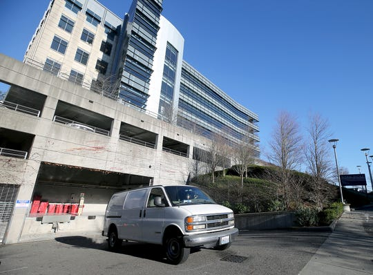 Lisa Al-Hakim director of operations of the People's Harm Reduction Alliance backs her van to the loading dock at the Norm Dicks Government Center on Thursday, December, 6, 2018.