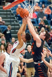 Galion's Hanif Donaldson battles Upper Sandusky's Jason Holly for a rebound.