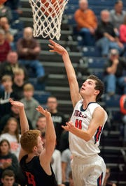 Galion's Jack Mcelligott shoots over Upper Sandusky's Cameron McCreary.