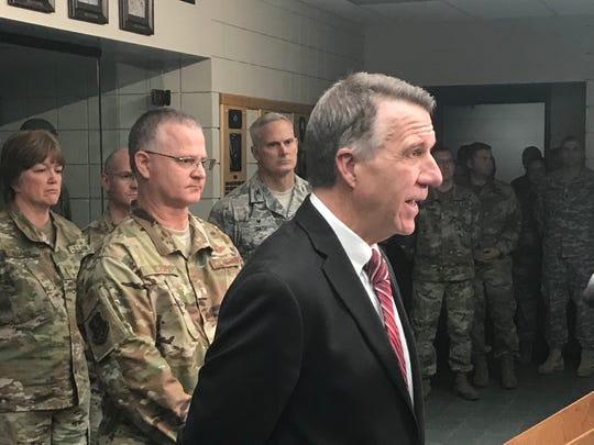 Gov. Phil Scott delivers remarks at the at a news conference addressing questions about the culture of the Vermont National Guard on Thursday, Dec. 6, 2018, at Camp Johnson in Colchester. Standing behind Scott is Maj. Gen. Steven Cray, adjutant general of the Vermont National Guard.