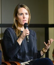 "Kate O'Neill, a marketing communications expert from Philadelphia, speaks during the opiods town hall on Wednesday, Dec. 5, 2018, at Champlain College in Burlington. She penned the obituary of her sister Madelyn Ellen Linsenmeir in October that resonated with many in Vermont and beyond, going viral online. O'Neill was one of six panelists who spoke Wednesday evening at the Burlington Free Press town hall titled ""Places of Incredible Darkness: Seeking Pathways Out of the Opioid Addiction Crisis in Vermont,"" hosted by Champlain College."