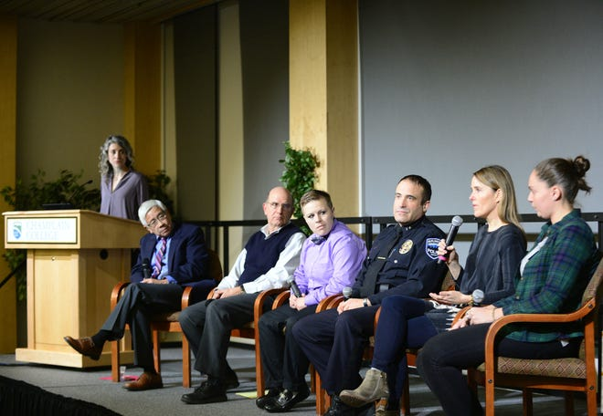 """From left, Free Press Digital Director Emilie Stigliani, From Vermont Health Commissioner Dr. Harry Chen, Gary De Carolis, executive director of the Turning Point Center, Katie Corey, whose addiction led her into the prison system and has faced challenges living in recovery, Burlington Police Chief Brandon del Pozo, Kate O'Neill, sister of Madelyn Ellen Linsenmeir and author of her obituary and Liza Ryan, a Champlain College student who is in recovery, sit on stage at the opioids town hall on Wednesday, Dec. 5, 2018, at Champlain College in Burlington. Six panelists spoke Wednesday evening at the Burlington Free Press town hall titled """"Places of Incredible Darkness: Seeking Pathways Out of the Opioid Addiction Crisis in Vermont,"""" hosted by Champlain College."""