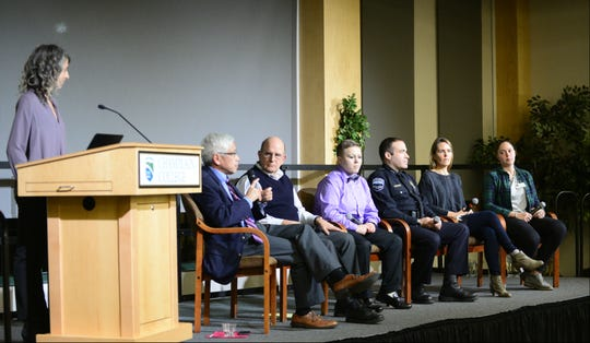 "From left, Free Press Digital Director Emilie Stigliani, From Vermont Health Commissioner Dr. Harry Chen, Gary De Carolis, executive director of the Turning Point Center, Katie Corey, whose addiction led her into the prison system and has faced challenges living in recovery, Burlington Police Chief Brandon del Pozo, Kate O'Neill, sister of Madelyn Ellen Linsenmeir and author of her obituary and Liza Ryan, a Champlain College student who is in recovery, sit on stage at the opioids town hall on Wednesday, Dec. 5, 2018, at Champlain College in Burlington. Six panelists spoke Wednesday evening at the Burlington Free Press town hall titled ""Places of Incredible Darkness: Seeking Pathways Out of the Opioid Addiction Crisis in Vermont,"" hosted by Champlain College."