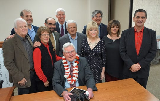 Former and current members of the Nueces County Commissioners Court and Corpus Christi City Council stand with County Judge Loyd Neal following Neal's retirement celebration on Dec. 6, 2018 at the county courthouse. Neal previously served as the city's mayor prior to his time as county judge.