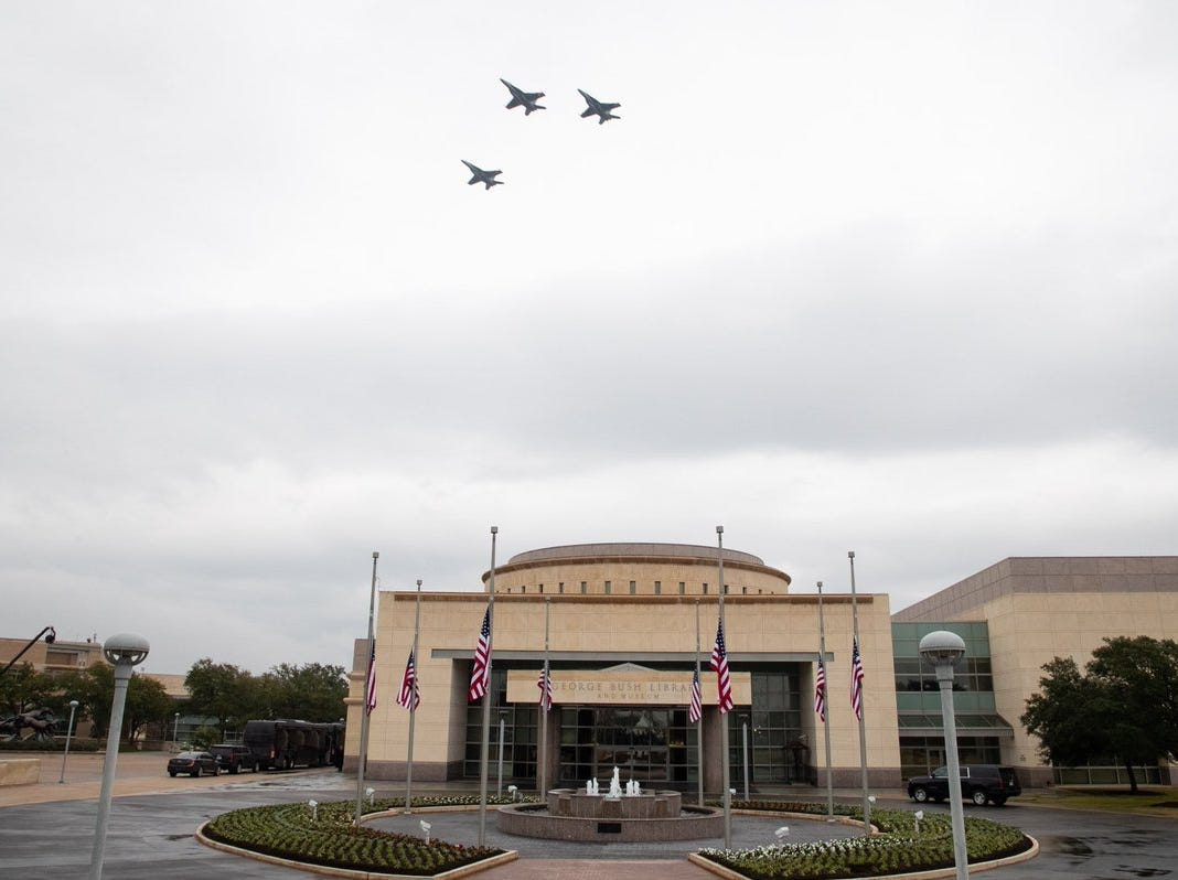 Jets in formation fly over the George Bush Presidential Library & Museum in College Station on Thursday, Dec. 6, 2018 as the hearse carrying the 41st president arrives.