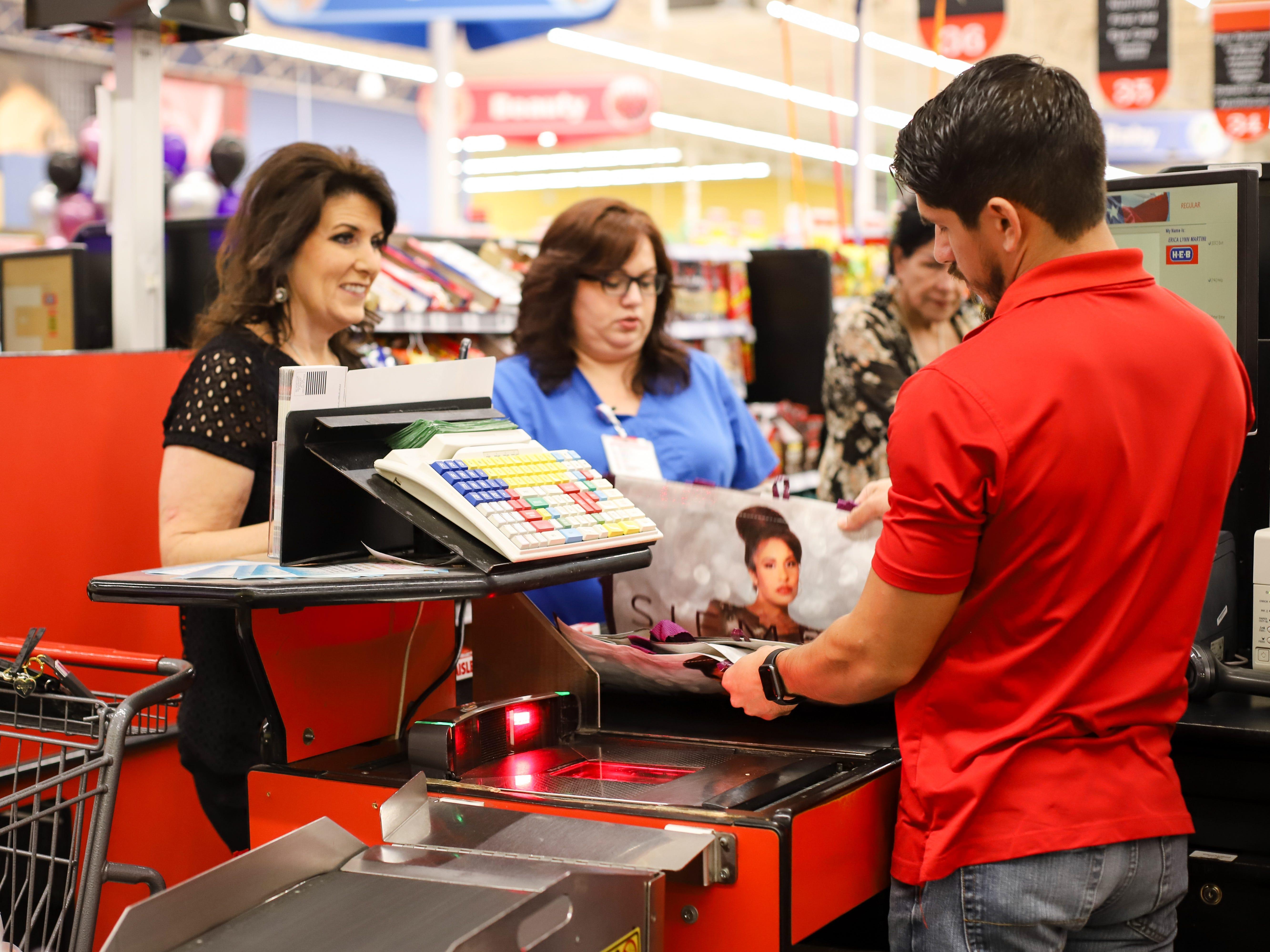 Customers purchase Selena reusable bags at the H-E-B Plus on Saratoga Boulevard in Corpus Christi on Dec. 6, 2018.