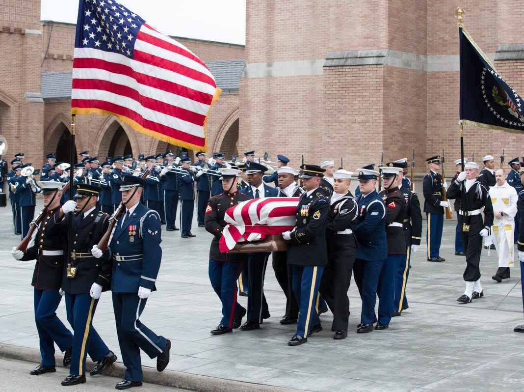 U.S. Service Members with the Ceremonial Honor Guard carry the casket of former President George H.W. Bush following the funeral service on Thursday, Dec. 6, 2018, at St. Martin's Episcopal Church in Houston, Texas.