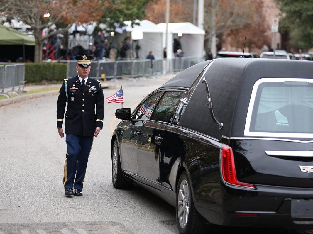 A U.S. Service member with the Ceremonial Honor Guard stands at attention outside St. Martin's Episcopal Church on Thursday, Dec. 6, 2018, for the funeral service of former President George H.W. Bush in Houston, Texas.